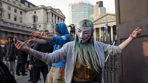 Occupy demonstrators dance near the Bank of England
