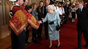 Queen Elzabeth II meets Huasos riders and dancers from Chile during a tea party for the cast of the Diamond Jubilee Pageant at Windsor