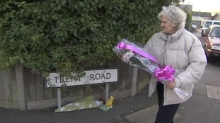 Shirley Semple a friend of May's laying flowers.