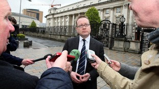 Northern Ireland Attorney General John Larkin speaking to reporters