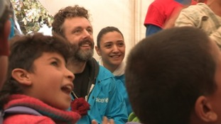 Michael Sheen joins in with children singing at a makeshift school in Lebanon