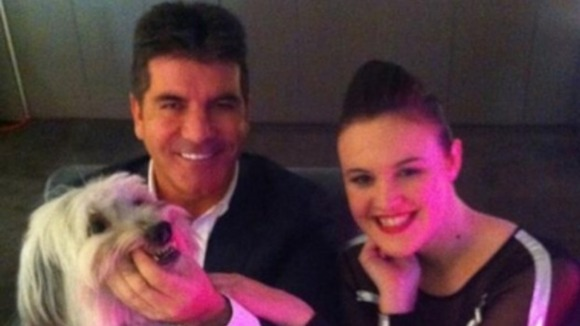 BGT judge Simon Cowell posted this picture on Twitter with competition winners Ashleigh and dog Pudsey.