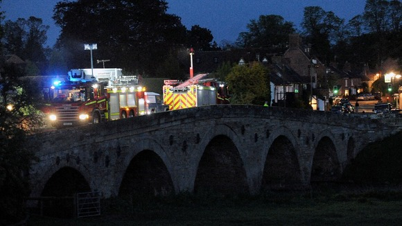 Emergency services seaching the River Avon after a boat capsized