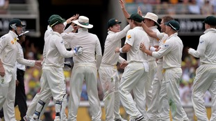 Australia celebrate after Nathan Lyon took the wicket of England's Chris Tremlett for 8 during day two of the first Ashes Test.