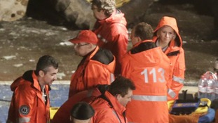 Rescue workers at the scene of the collapse.