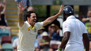 Australia's Mitchell Johnson celebrates the wicket of Michael Carberry in the first Ashes test.
