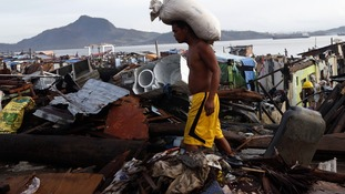 A Typhoon Haiyan survivor picture today in the devastated Tacloban city.