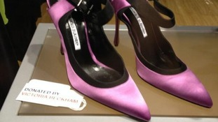 A pair of Manolo Blahnik's donated by Victoria Beckham.