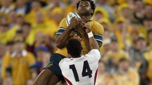 Jason Robinson grapples with Australia's Lote Tuqiri