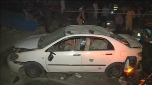 Twin blasts have killed at least seven in Pakistan's Karachi.