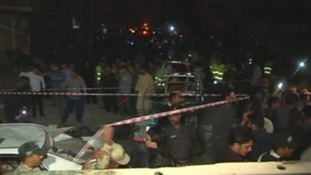 Shops, cars and a motorcycle were destroyed in the blasts.