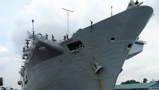 HMS Illustrious sails off on aid mission to Philippines