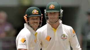 David Warner (left) and Michael Clarke (right) during day three of the first Ashes Test at The Gabba, Brisbane, Australia.