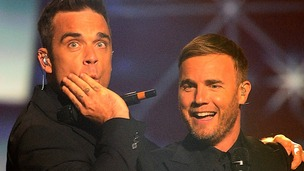 Robbie Williams and Gary Barlow on stage at the 2011 National Movie Awards.