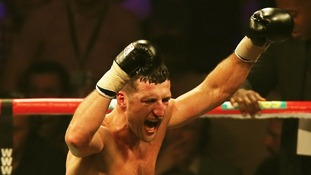 Carl Froch celebrates following a ninth round stoppage in his WBA and IBF Super Middleweight Title fight against George Groves.