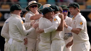 Australia's cricketers celebrate during day four of the first Ashes Test at The Gabba, Brisbane, Australia