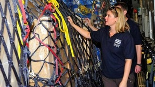 International Development Secretary Justine Greening inspects the aid on board the RAF C-17 Globemaster.