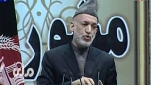 Afghan President Hamid Karzai addresses the Loya Jirga assembly.