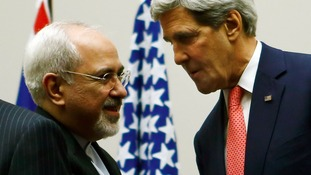 US Secretary of State John Kerry shakes hands with Iranian Foreign Minister Mohammad Javad Zari.