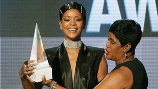 Rihanna accepts the Icon Award from her mother Monica Fenty.