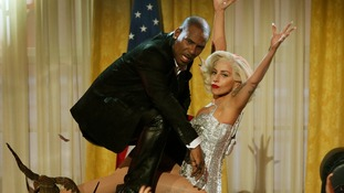 R. Kelly and Lady Gaga performing at the AMAs