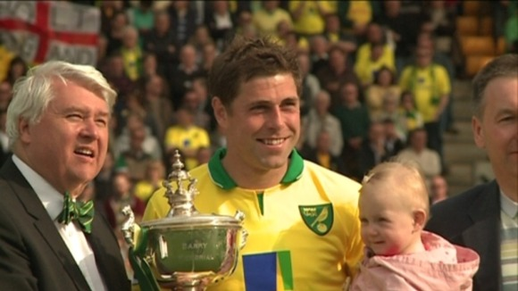 Norwich City captain Grant Holt poses with Barry Butler Memorial Trophy with chairman Alan Bowkett