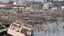 Scenes of devastation after Typhoon Haiyan battered Tacloban city