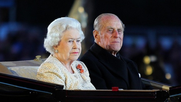 Queen Elizabeth II and the Duke of Edinburgh arrive at the Diamond Jubilee Pageant in Windsor