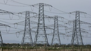 General view of electricity pylons near Lydd, Kent.