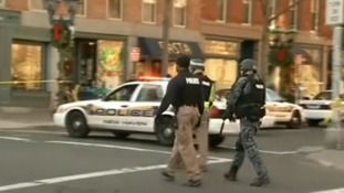 Armed police walk towards Yale University's Old Campus.
