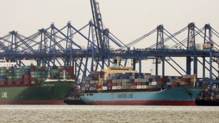 A report by MPs says the port of Felixstowe is one of several around the country being hindered by road and rail bottlenecks.