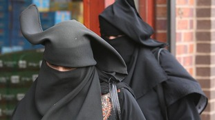 Two women in Blackburn both wearing a niqab