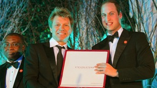 The prince presents Jon Bon Jovi with the Centrepoint Great Britain Youth Inspiration Award.