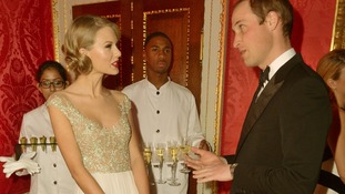 Taylor Swift and Prince William chat before their performance.