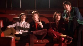 The collection contains previously unpublished colour pictures of The Beatles pretending to watch the film.
