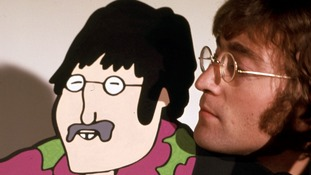 John Lennon with his animated self.