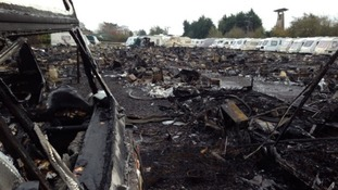 The remains of 50 caravans destroyed in the fire