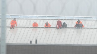 The six prisoners protest on the roof of HMP Oakwood
