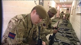 Grenadiers checking weapons