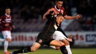 Kane Ferdinand challenges Fleetwood Town midfielder Antoni Sarcevic in a recent match.