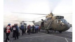 Justine Greening posted this image of a helicopter from HMS illustrious delivering aid to cut off islands.