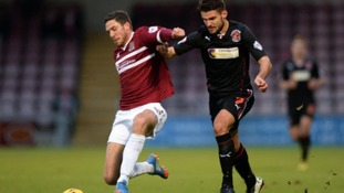 Ben Tozer challenges for the ball in Northampton's recent clash with Fleetwood Town.