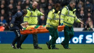 Anthony Pilkington is carried off the pitch at Newcastle.