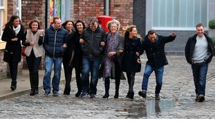 Cast members from Coronation Street walk along the cobbles of the new set during a photocall at Media City, Manchester