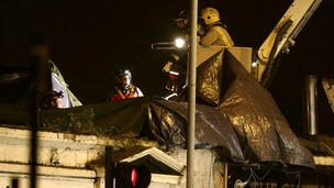 Members of the emergency services working on the roof of the Clutha Bar in Glasgow