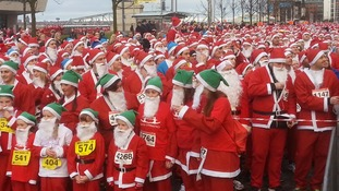 Thousands of people dressed as Santa