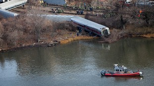 Emergency workers gather at the site of a Metro-North train derailment in the Bronx borough of New York.