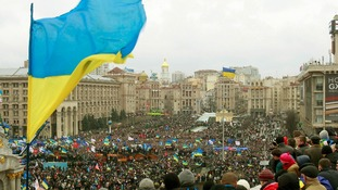 Crowds of supporters of EU integration listen to opposition leader Vitaly Klitschko in central Kiev
