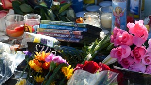 Flowers and movies left by fans at the scene of the car crash where actor Paul Walker was killed.