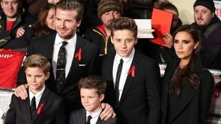 David and Victoria Beckham with their children Brooklyn (back), Romeo (left) and Cruz (right).